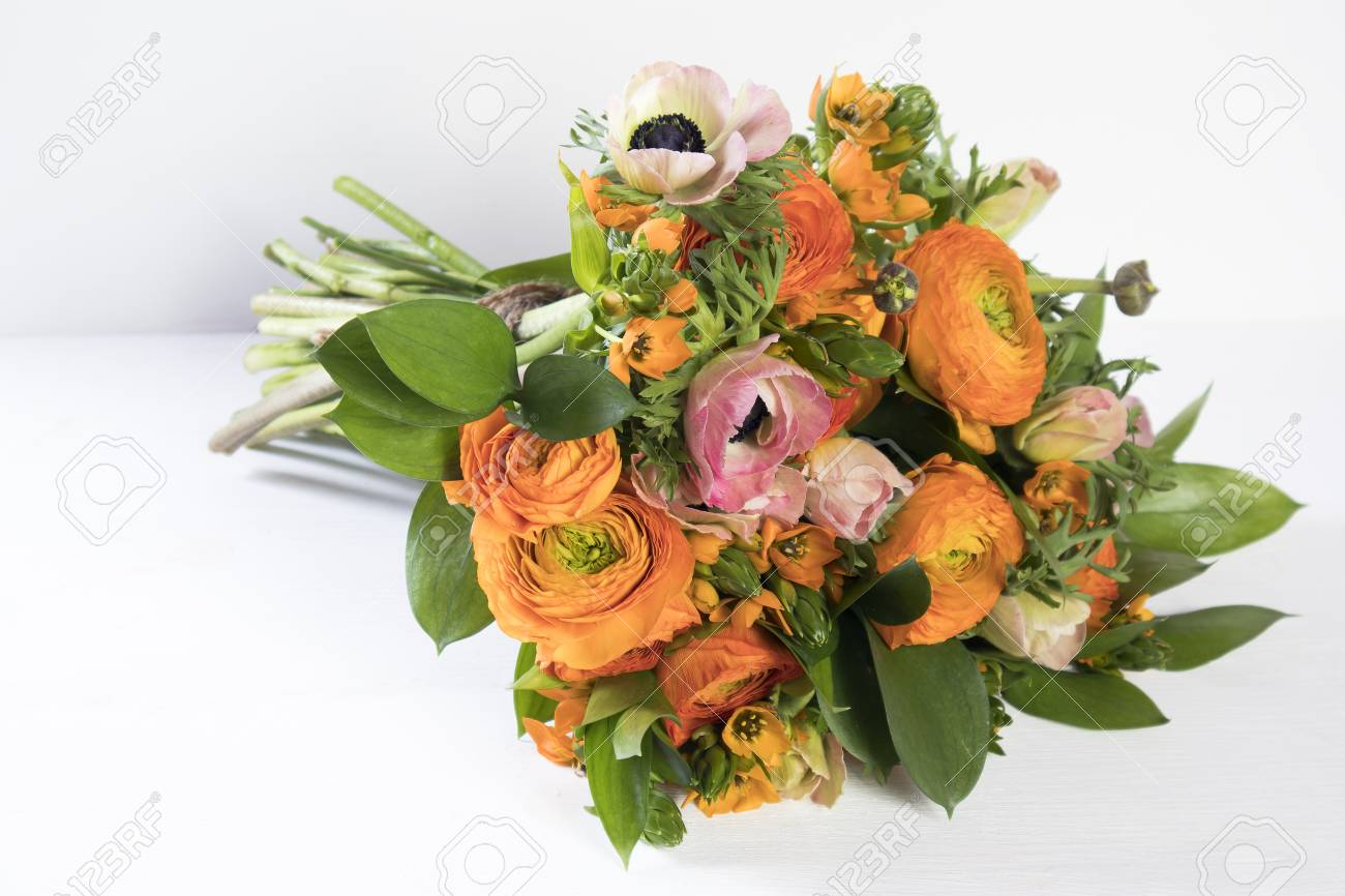 A wedding bouquet of buttercups anemones and ruscus on the white a wedding bouquet of buttercups anemones and ruscus on the white background stock photo izmirmasajfo