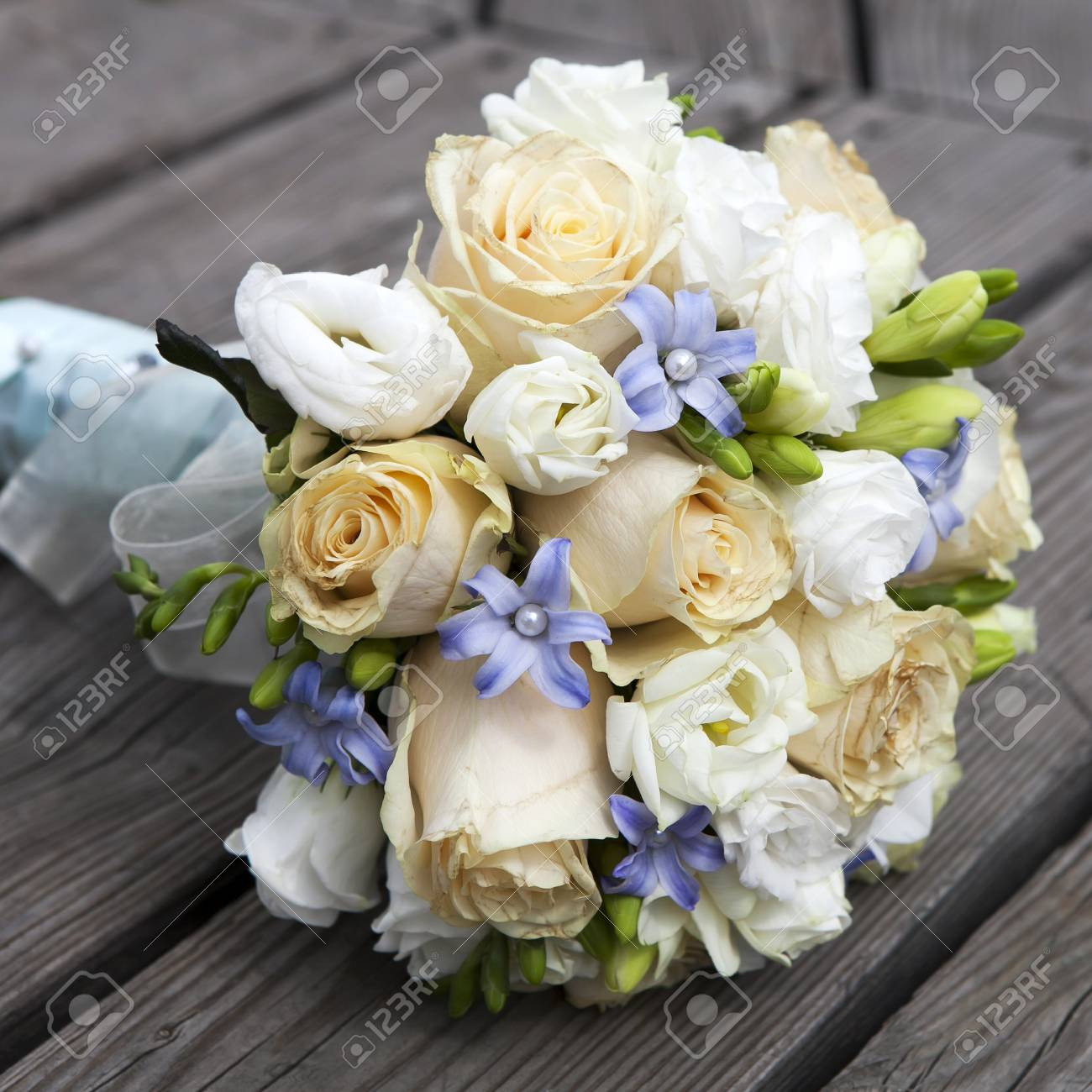 Wedding Bouquet Of Yellow And White Roses And Blue Fresia Lying