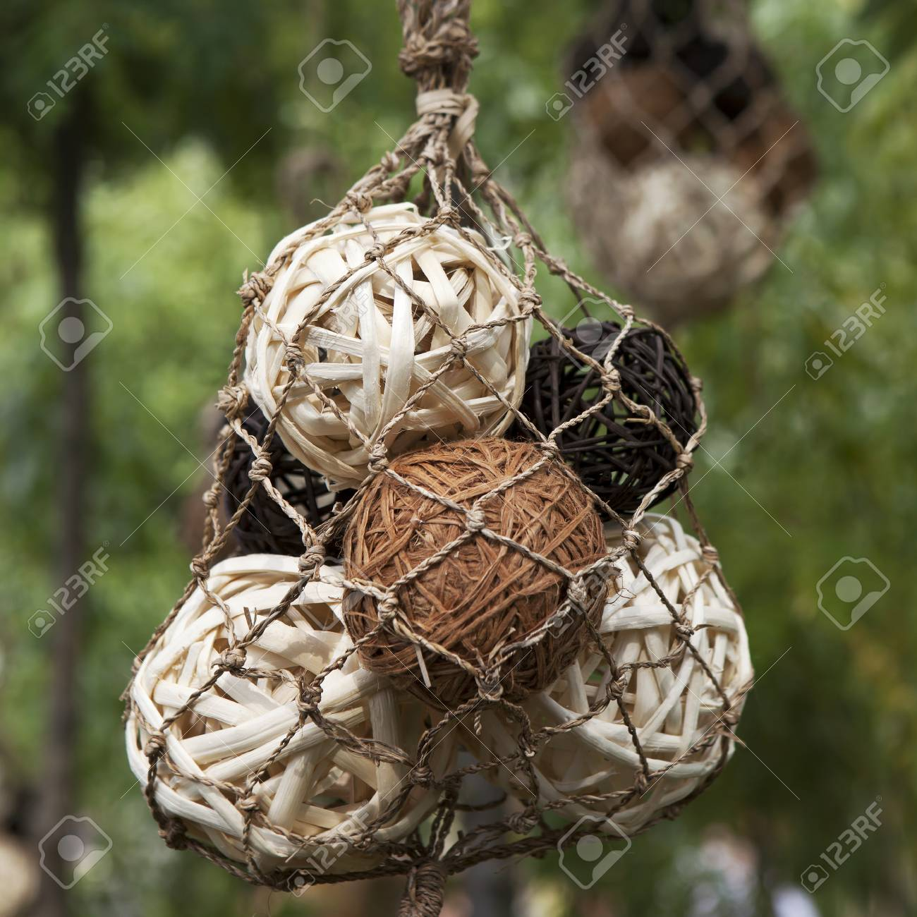 Decoration Of Garden.White And Brown Balls Of Vines Hanging In ...