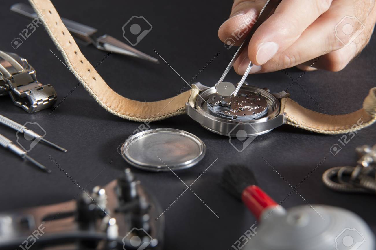 Close up of replacing a watch battery with watchmaker tools - 108457286