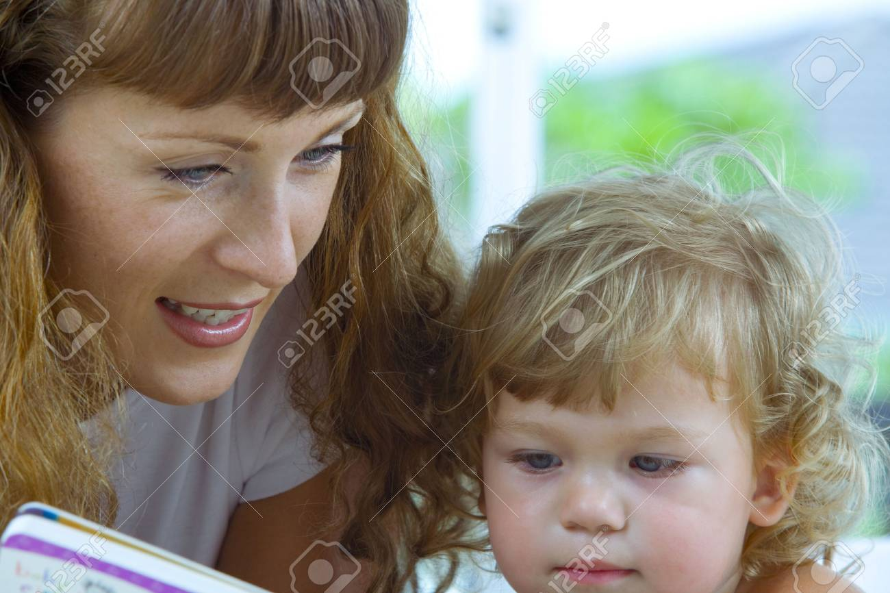 High key portrait  of young baby getting busy with the book Stock Photo - 3541736