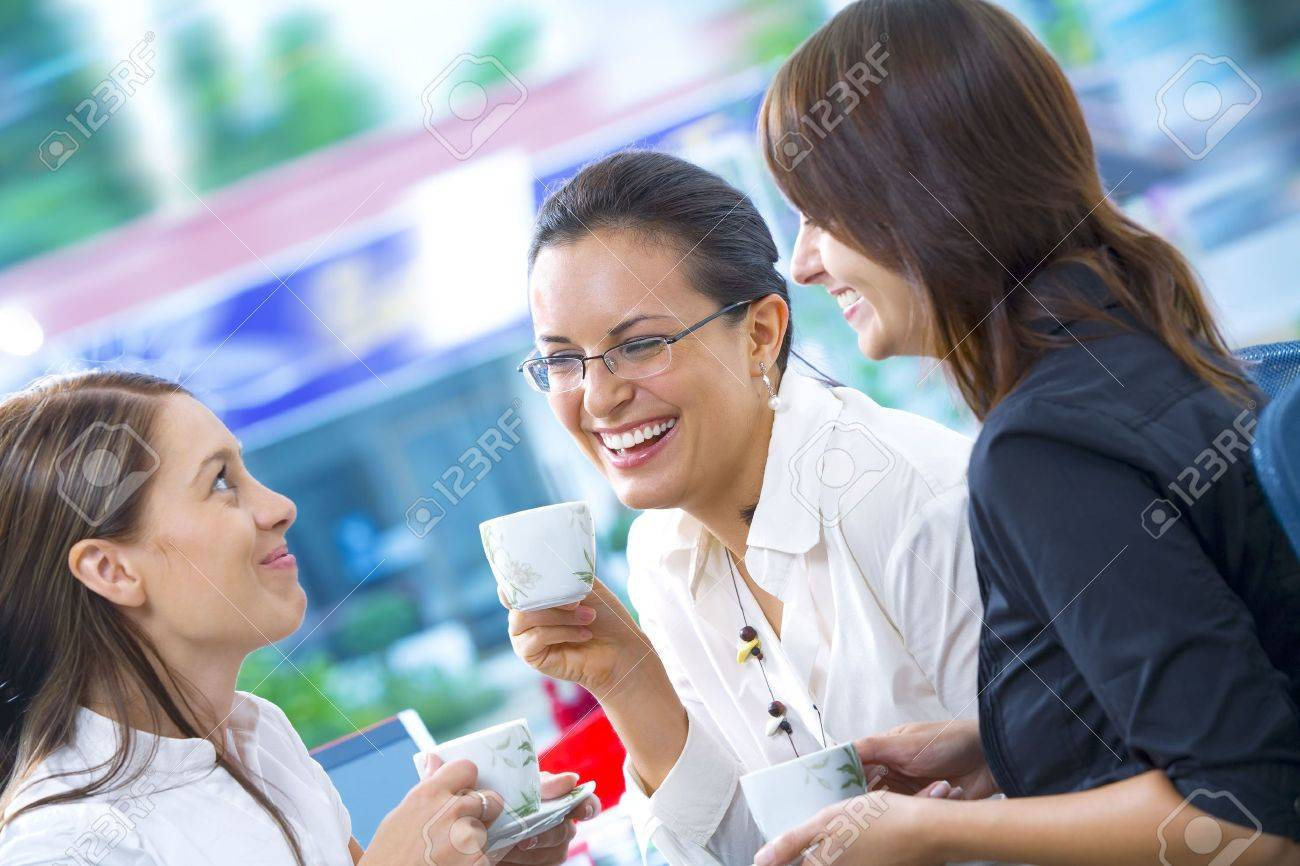 Portrait of young pretty women having coffee break in office environment Stock Photo - 3988482