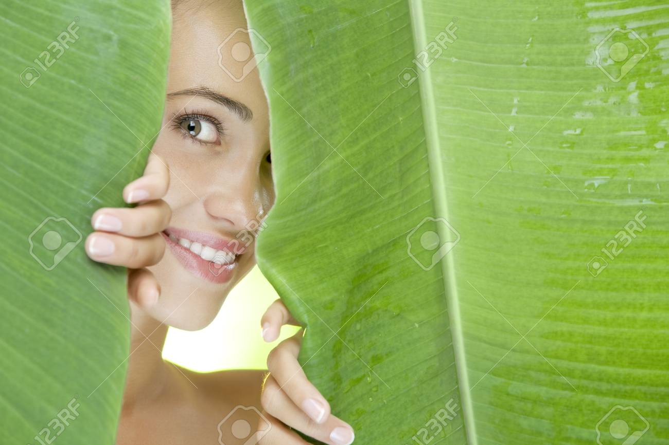 portrait of young beautiful woman on green leafs back Stock Photo - 4976722