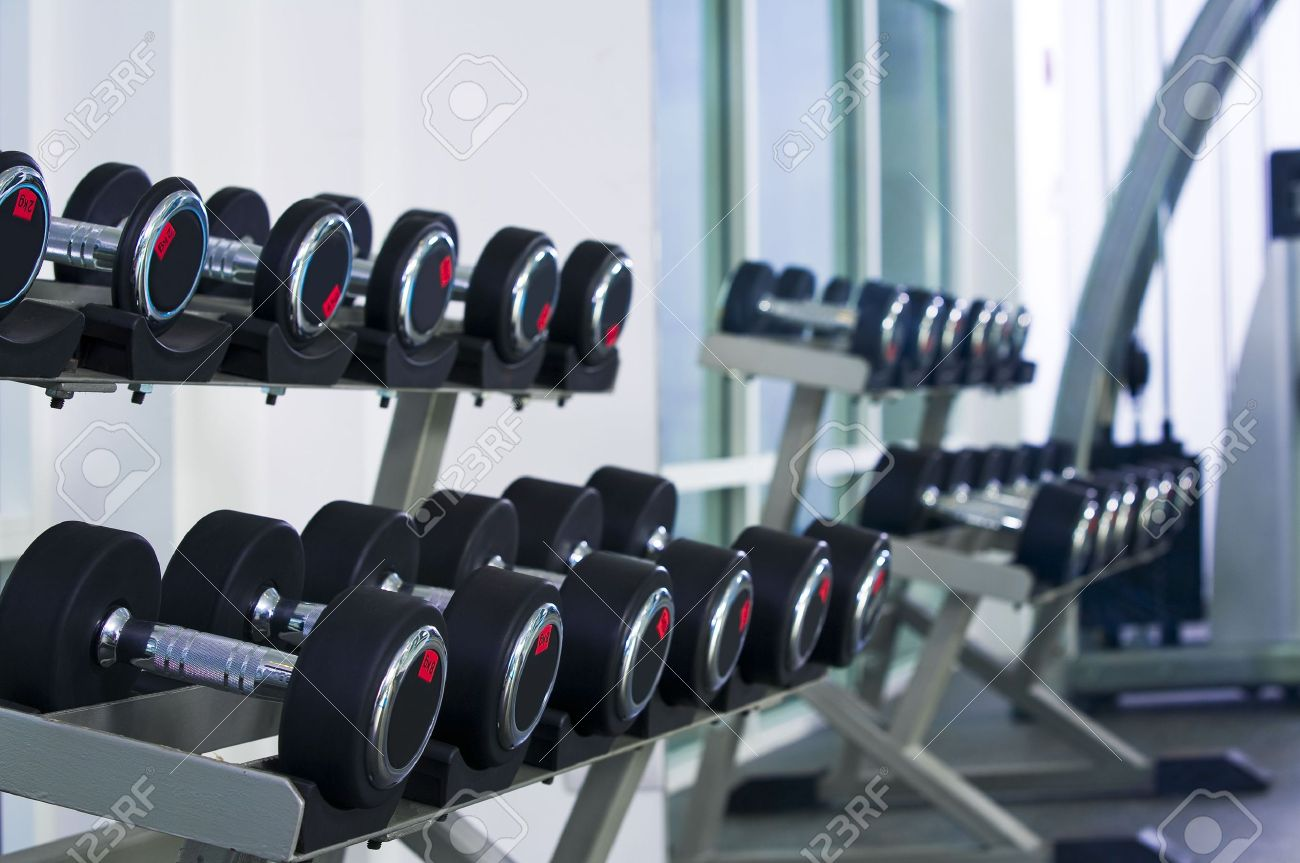 Fragment like  view of gym interior  with some dumbbells Stock Photo - 5294243