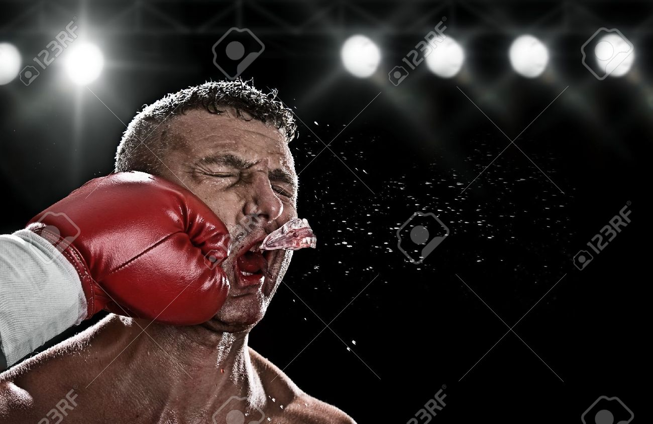 low key portrait of boxer getting knocked out - 7197378