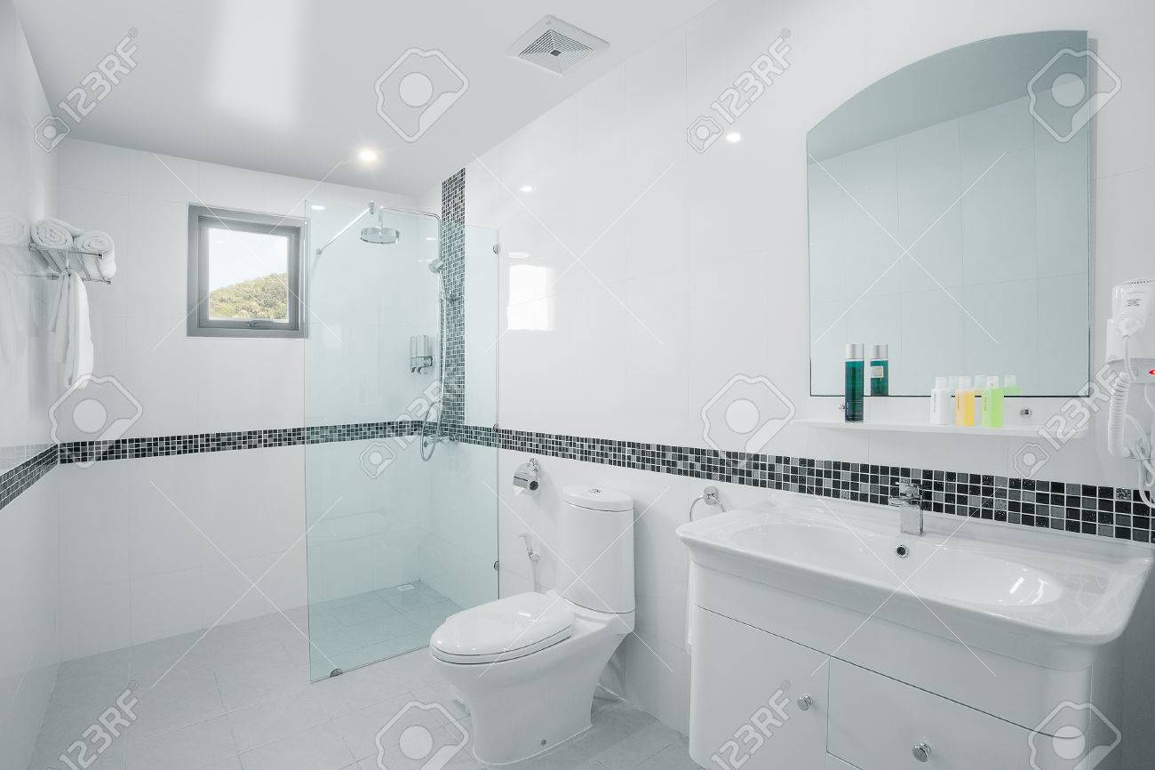 View Of Nice White Tiled Modern Restroom Stock Photo, Picture And ...