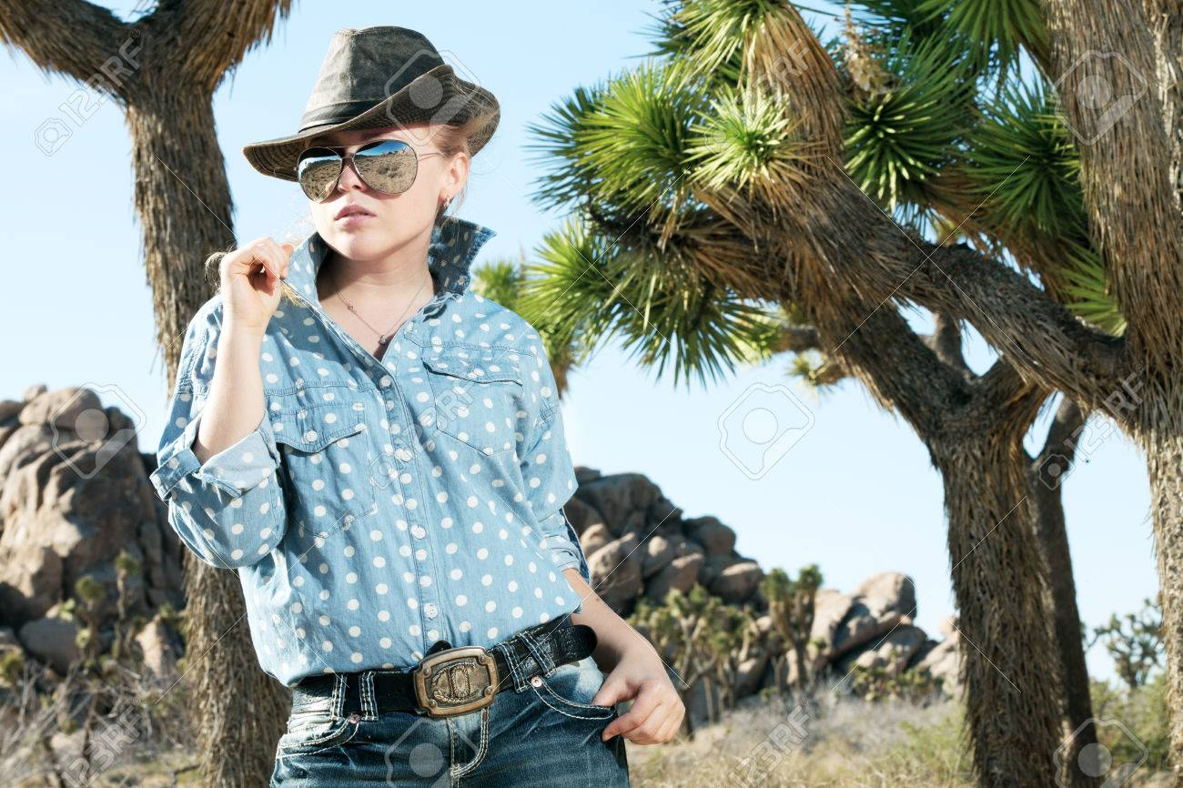portrait of young beautiful girl in Joshua Tree park environment Stock Photo - 29108118