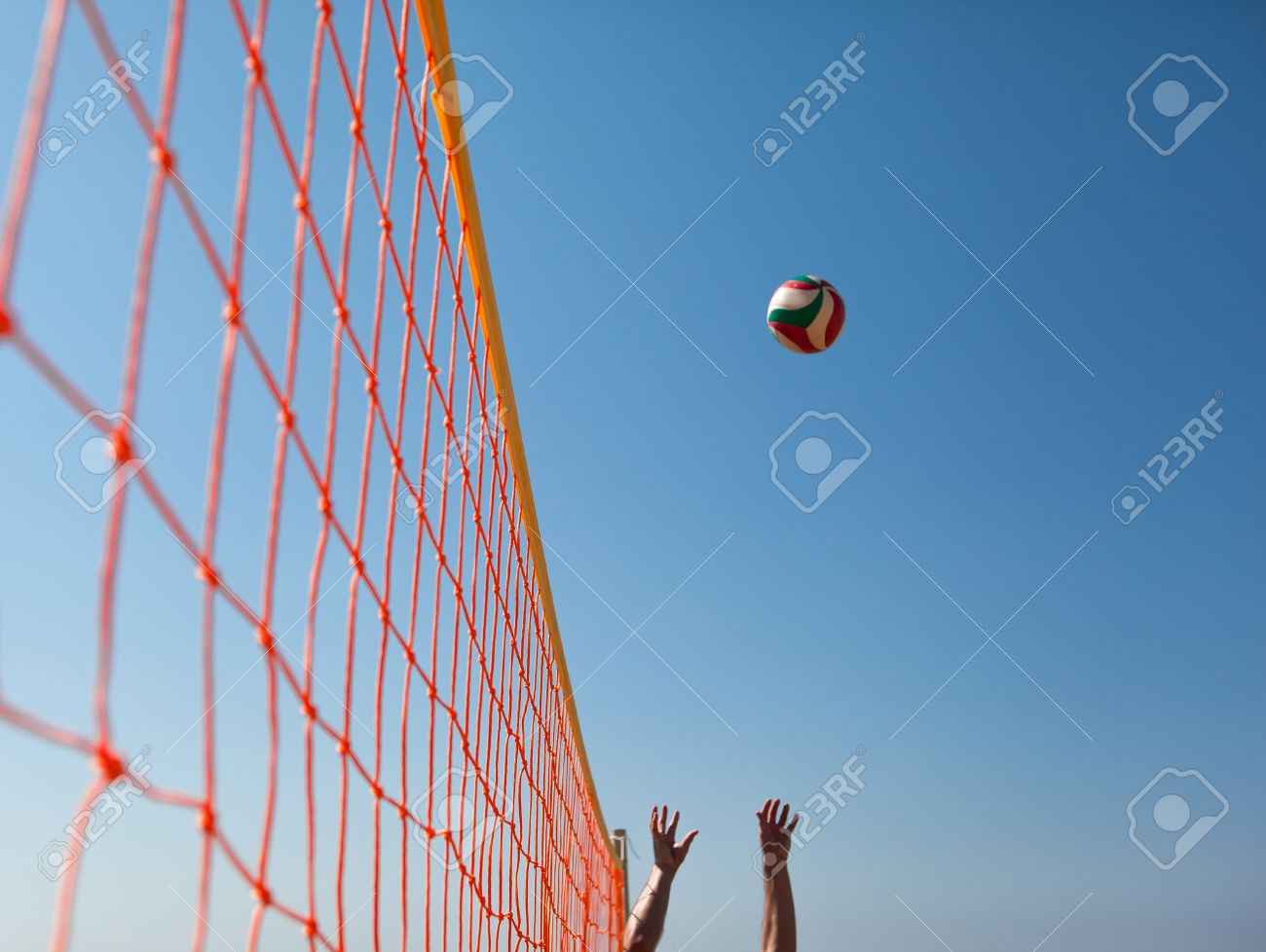 Volleyball ball over net stock photo. Image of sphere 62200542.