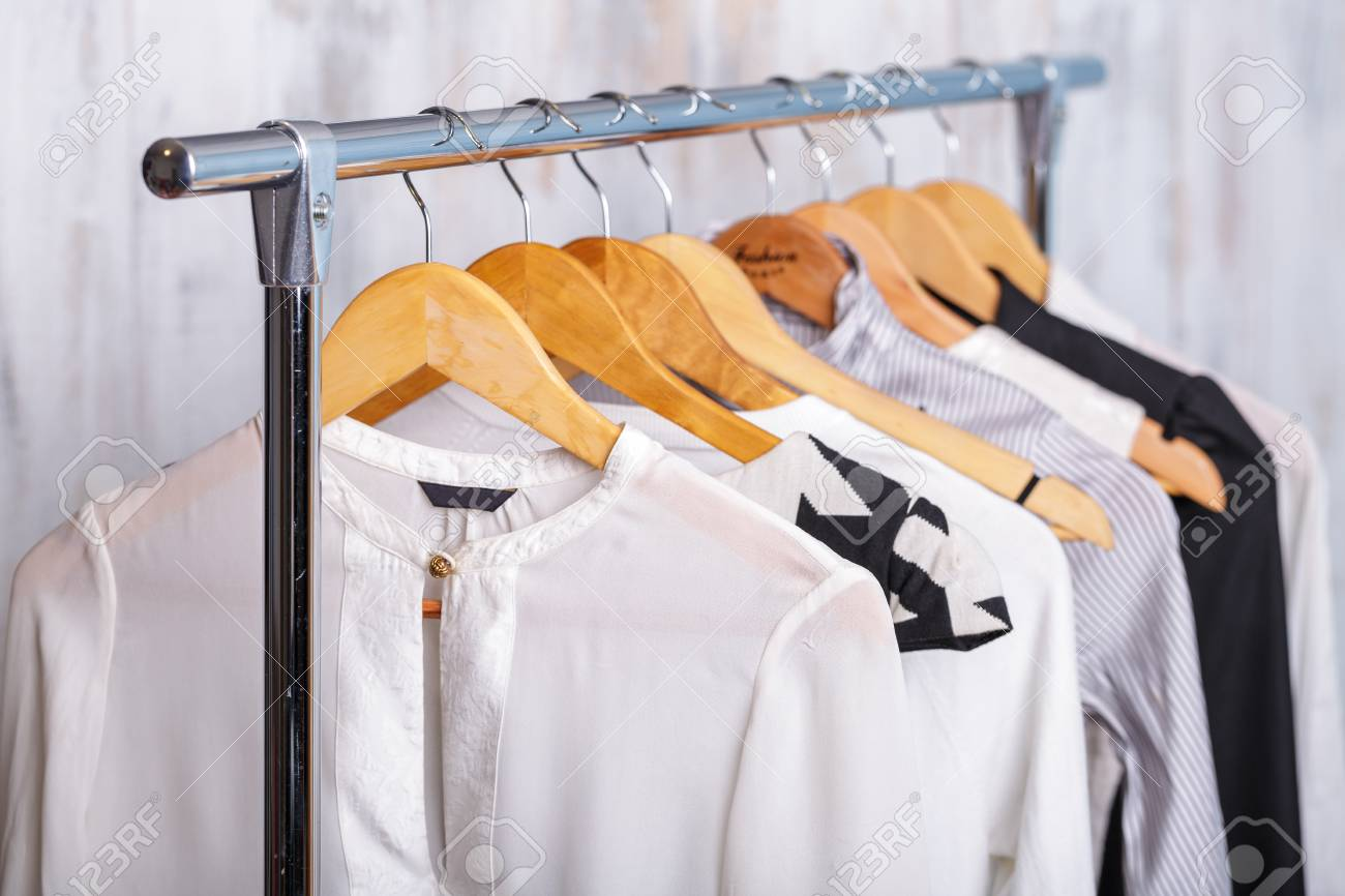 a5a8058d889 black and white womens clothes on hangers on rack in fashion sto Stock  Photo - 71523294