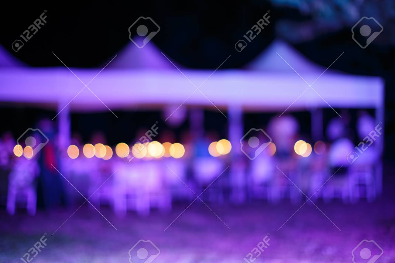 Blurred Background Table For Wedding Reception Under Tent In Stock