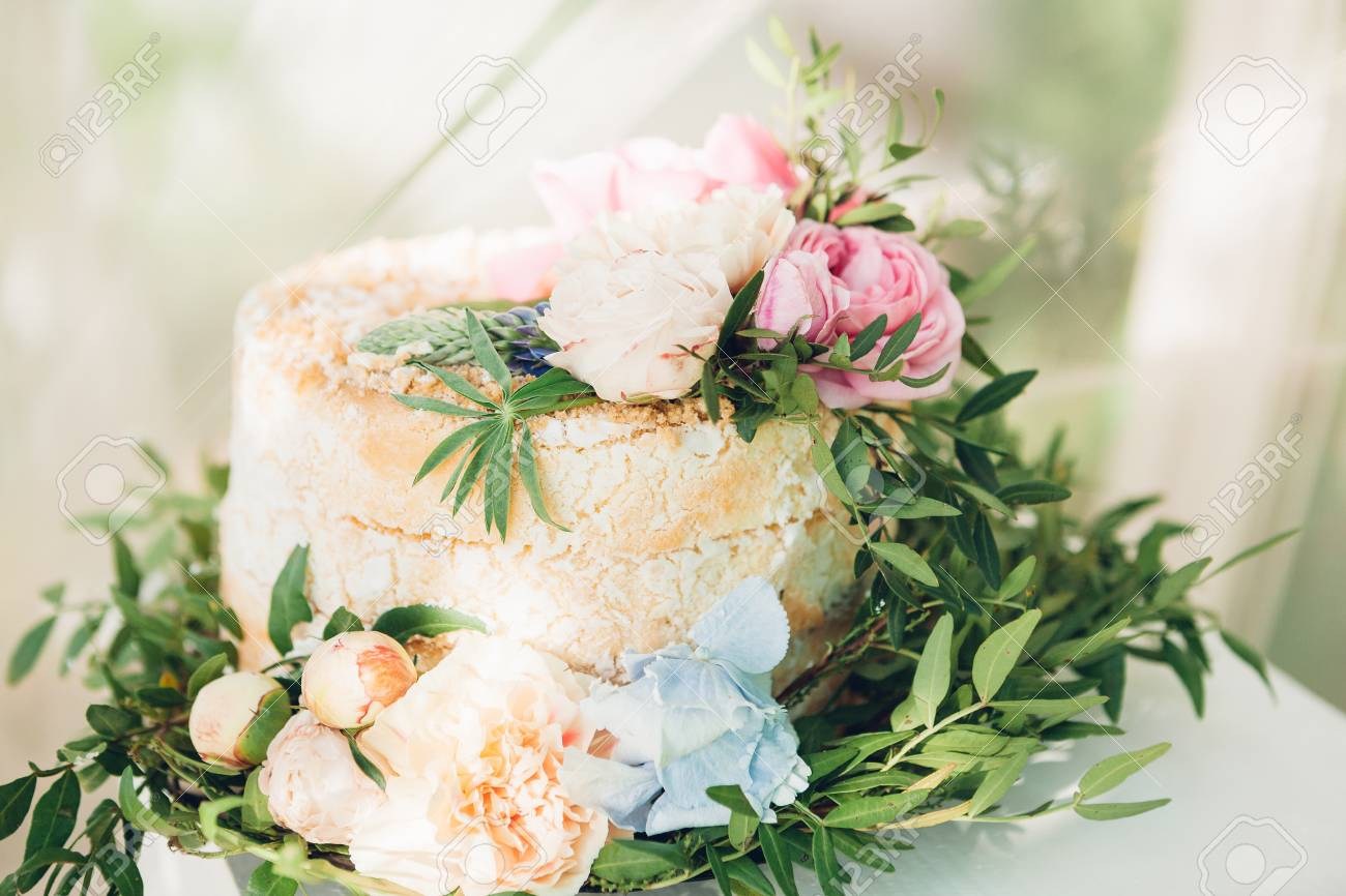 Wedding Cake Decorated With Fresh Flowers Stock Photo Picture And