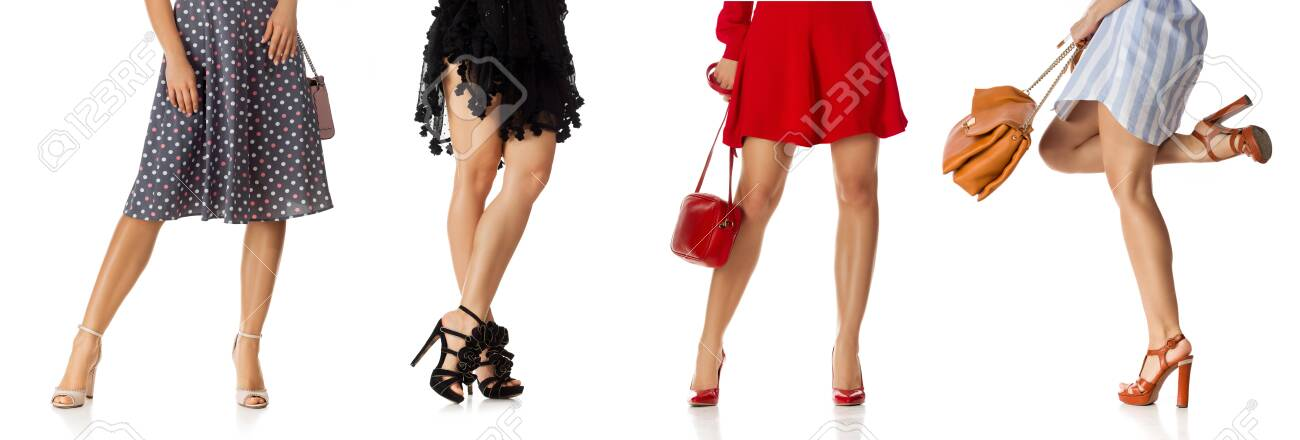 different woman in various dress standing with stylish purse bag and high heels shoes isolated on white background. - 128613305