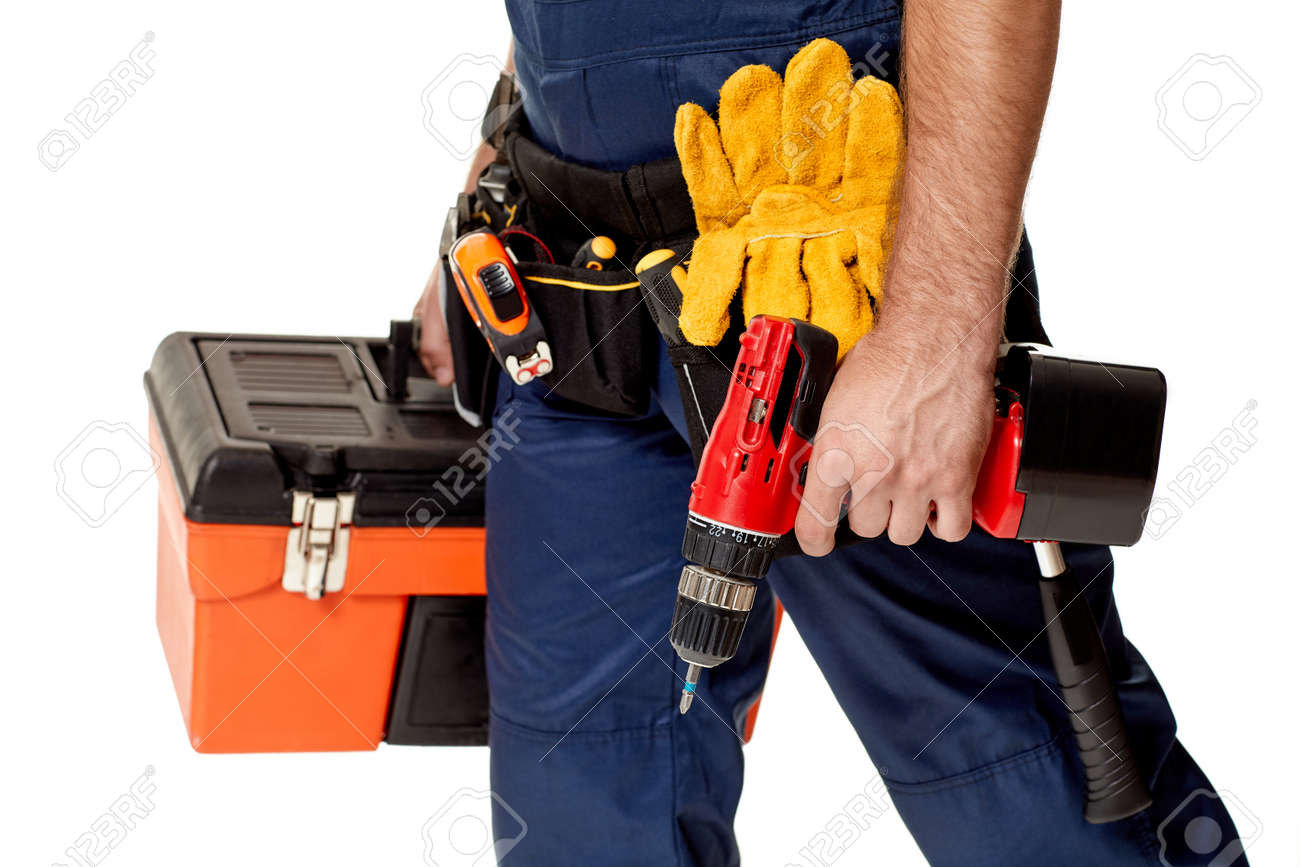 repairman holding cordless screwdriver and tool box. handyman with working tools on belt - 151364887