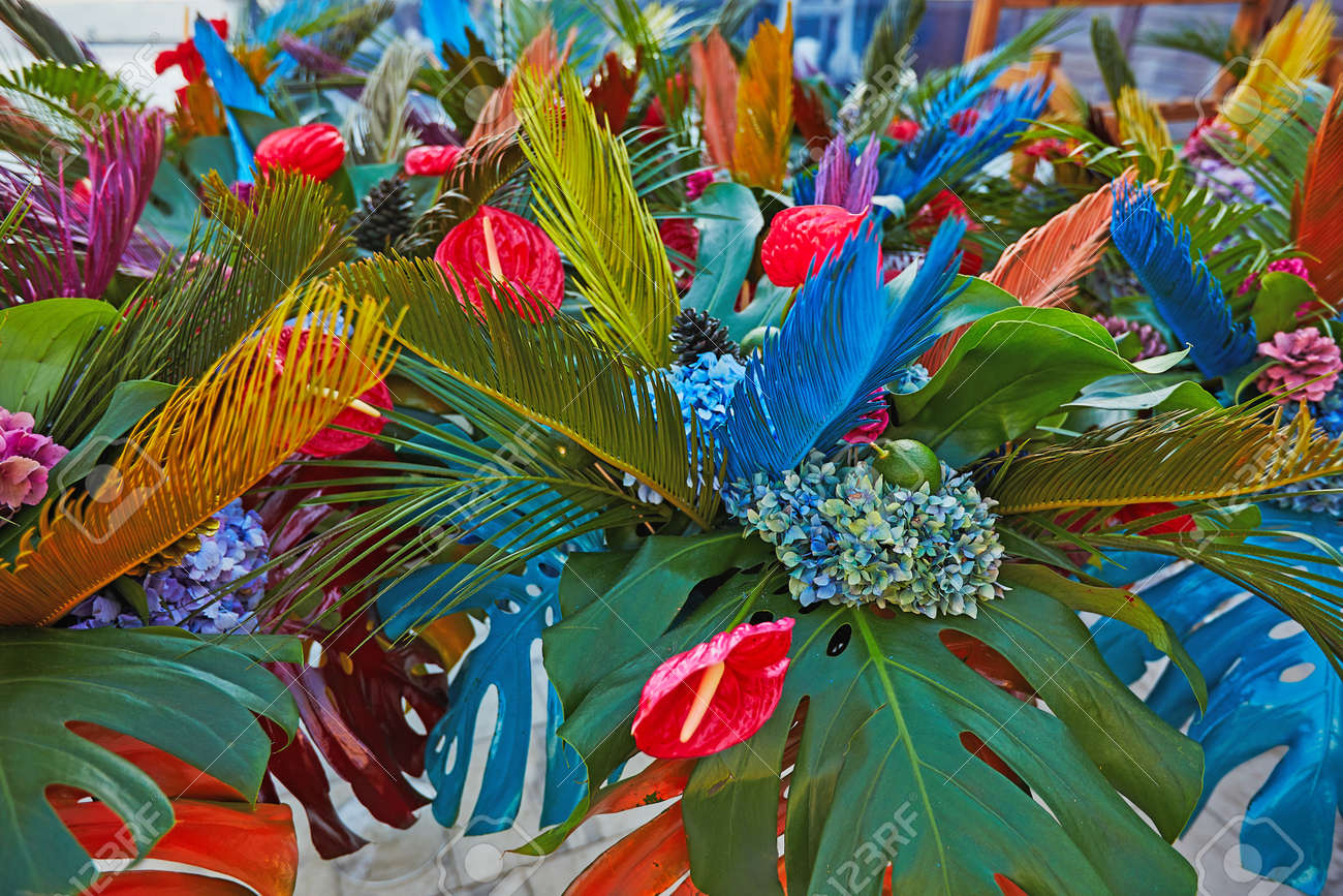 Bouguets of monstera for tables decoration on wedding or corporative event - 143456023