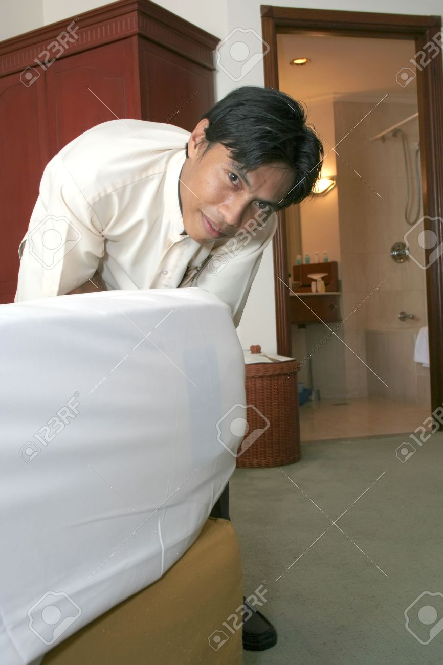 housekeeping or room boy at work stock po 5228218