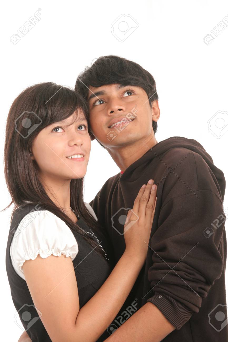 happy couple look to copy space above Stock Photo - 4466799