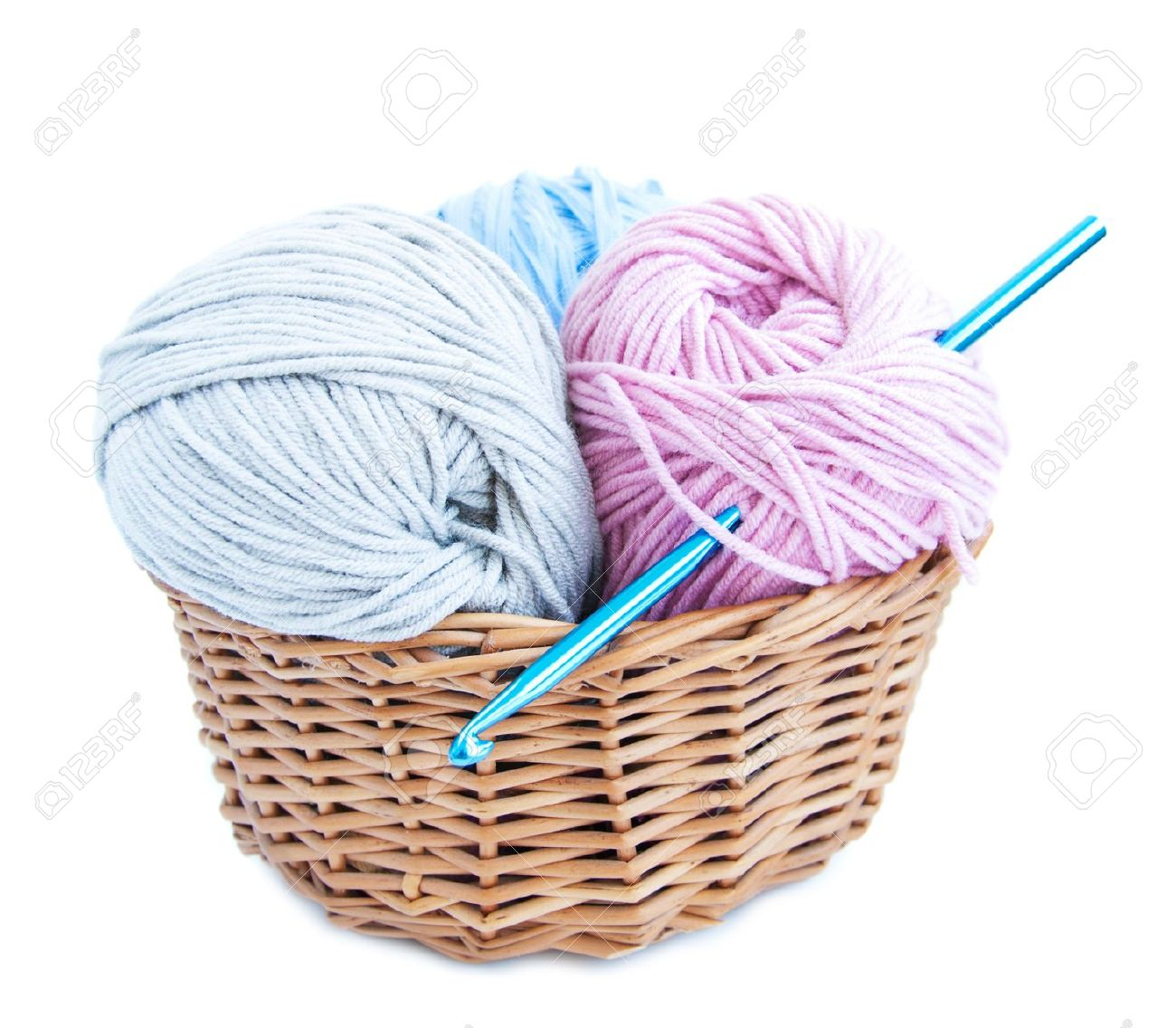 Basket With Crochet Hook And Yarn On A White Background Stock Photo