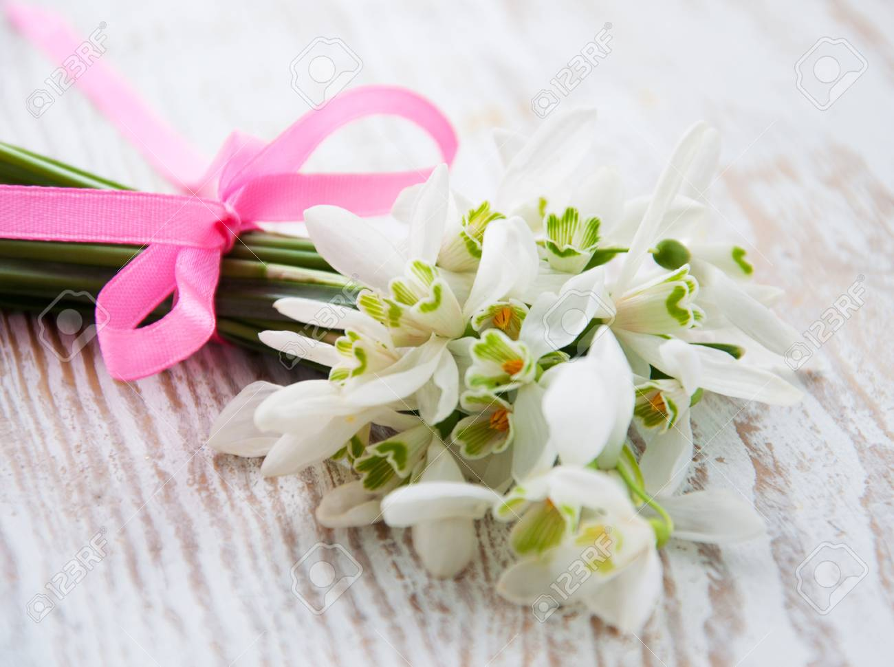Bunch Of Snowdrop Flowers On Old Wooden Background Stock Photo