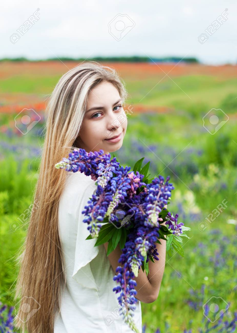 Beautiful girl with bouquet of lupine flowers in hands stock photo beautiful girl with bouquet of lupine flowers in hands stock photo 62788590 izmirmasajfo