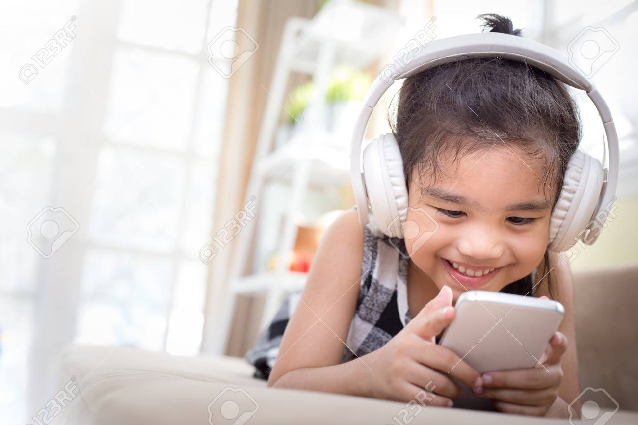 Happy Asian Girl Using Headphone For Listen Music By Smartphone ...