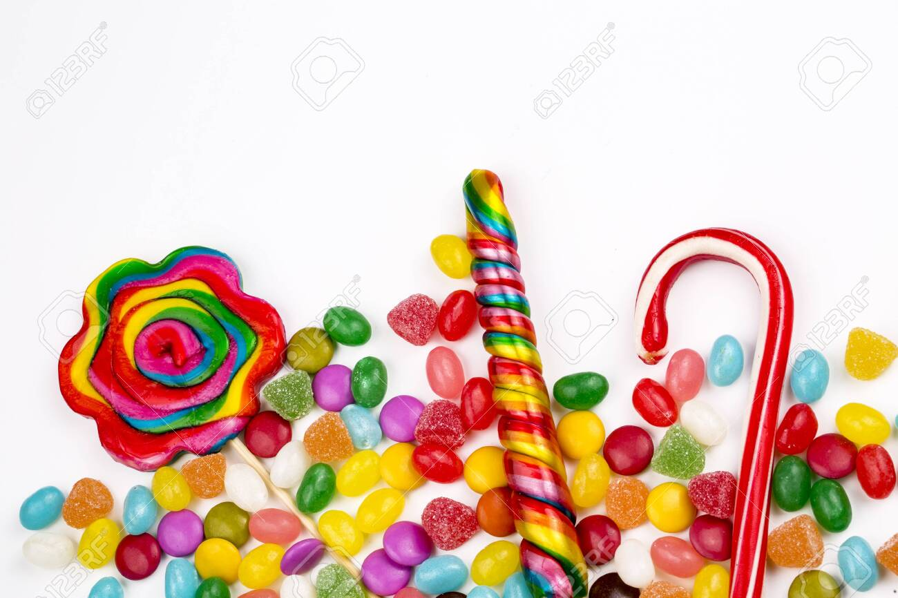Colorful lollipops and different colored round candy. Top view. - 152779303