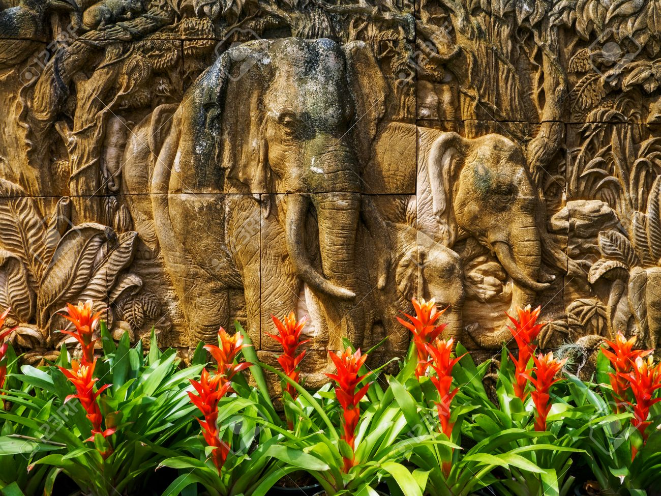 Stone Low Relief In The Summer Garden. Jungle Theme Stock Photo ...