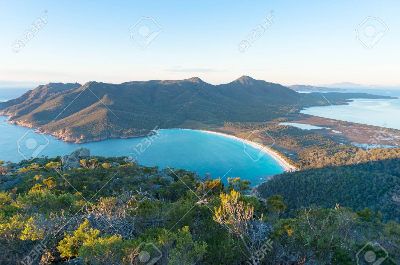 Aerial view of picturesque beach and mountains on sunny morning. Freycinet Park, Tasmania. Australia - 79077577