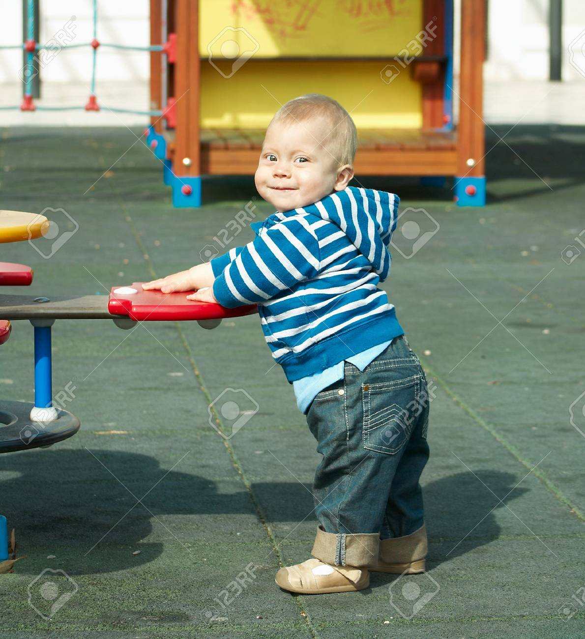 A small child playing in the street Stock Photo - 5063014