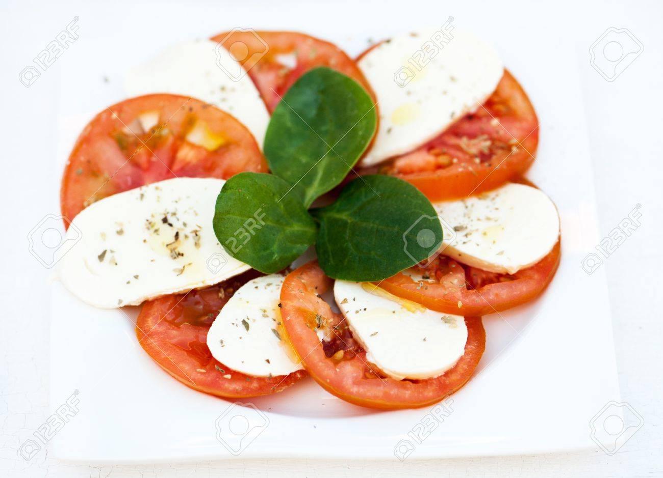 Italian salad with tomatoes and mozzarella Stock Photo - 20351722