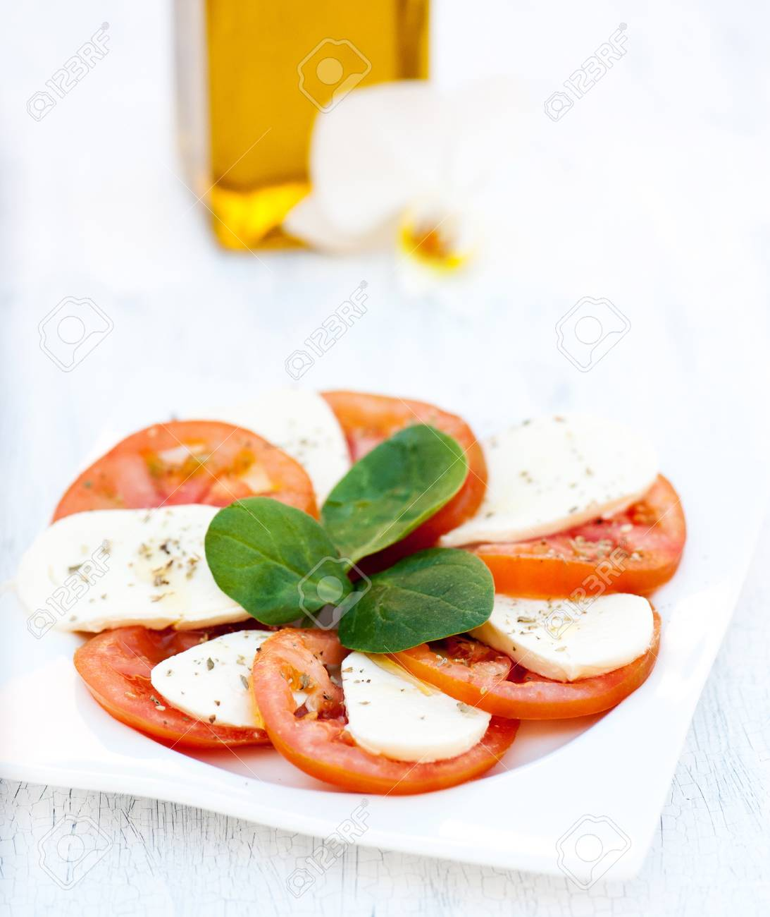 Italian salad with tomatoes and mozzarella Stock Photo - 20753720