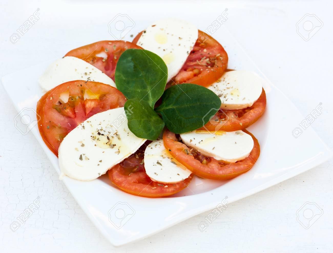 Italian salad with tomatoes and mozzarella Stock Photo - 20753721