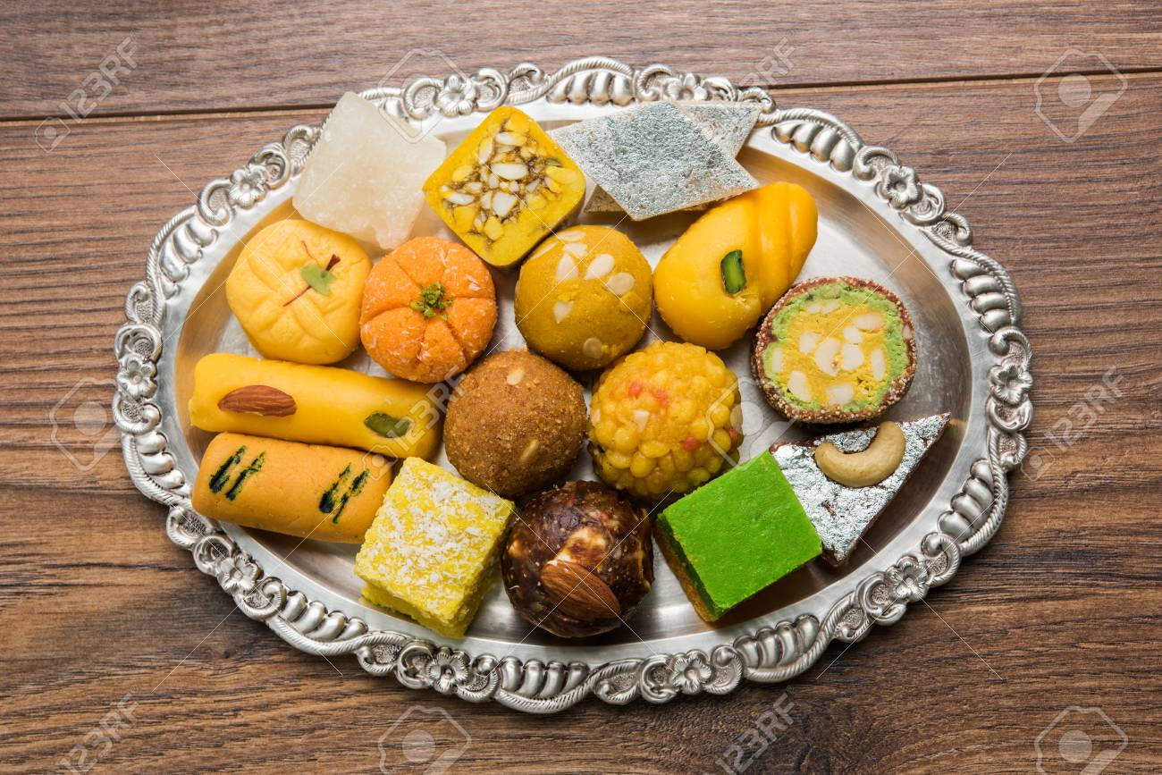 Stock Photo Of Indian Sweets Served In Silver Or Wooden Plate Stock Photo Picture And Royalty Free Image Image 87182063