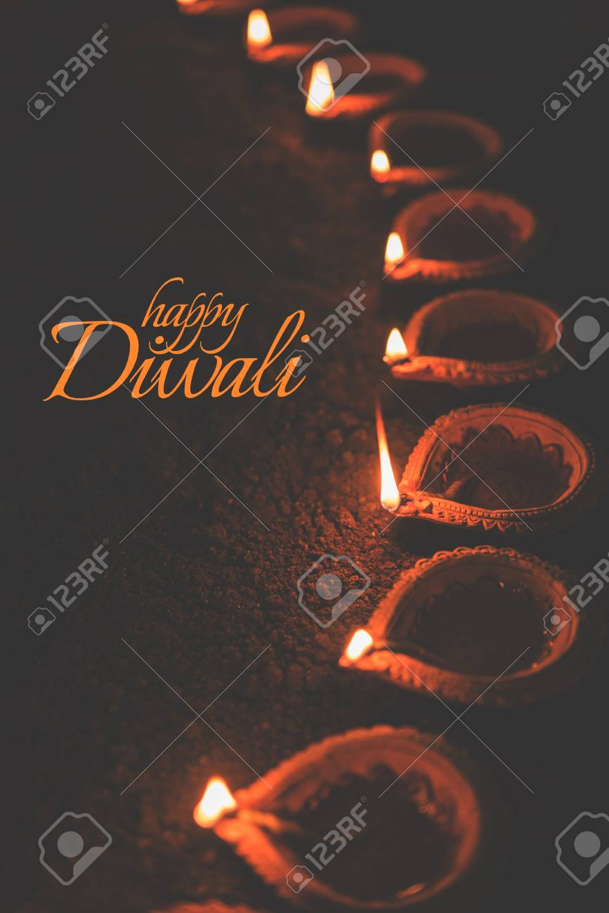 Happy diwali greeting card design using beautiful clay diya lamps happy diwali greeting card design using beautiful clay diya lamps lit on diwali night celebration m4hsunfo