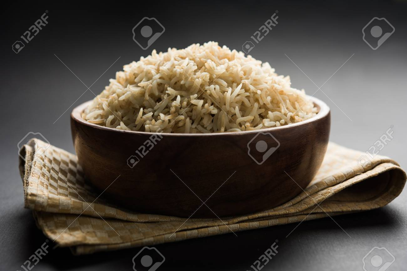Stock Photo of cooked Brown Basmati rice served in a bowl, selective focus - 87446975