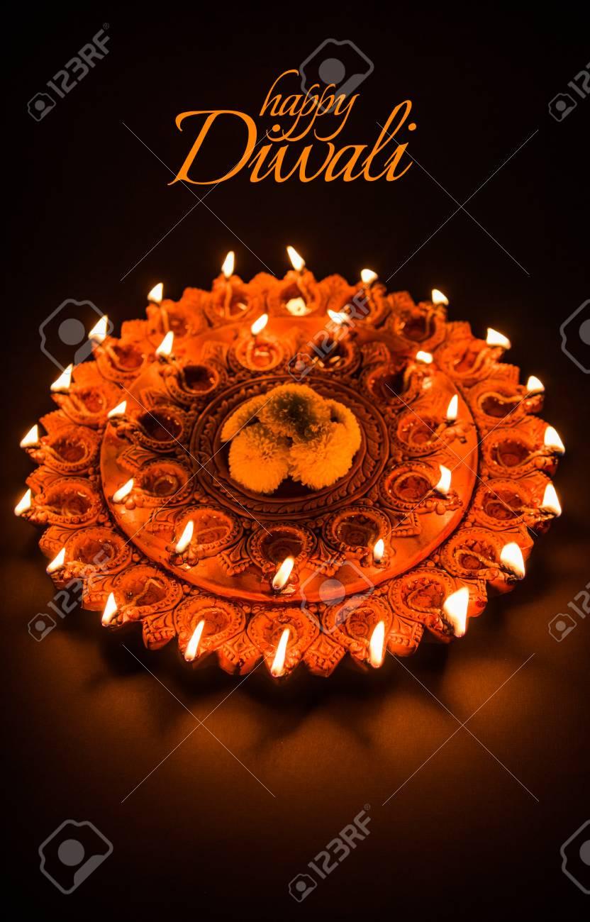 Happy Diwali Greeting Card Design Using Beautiful Clay Diya Lamps