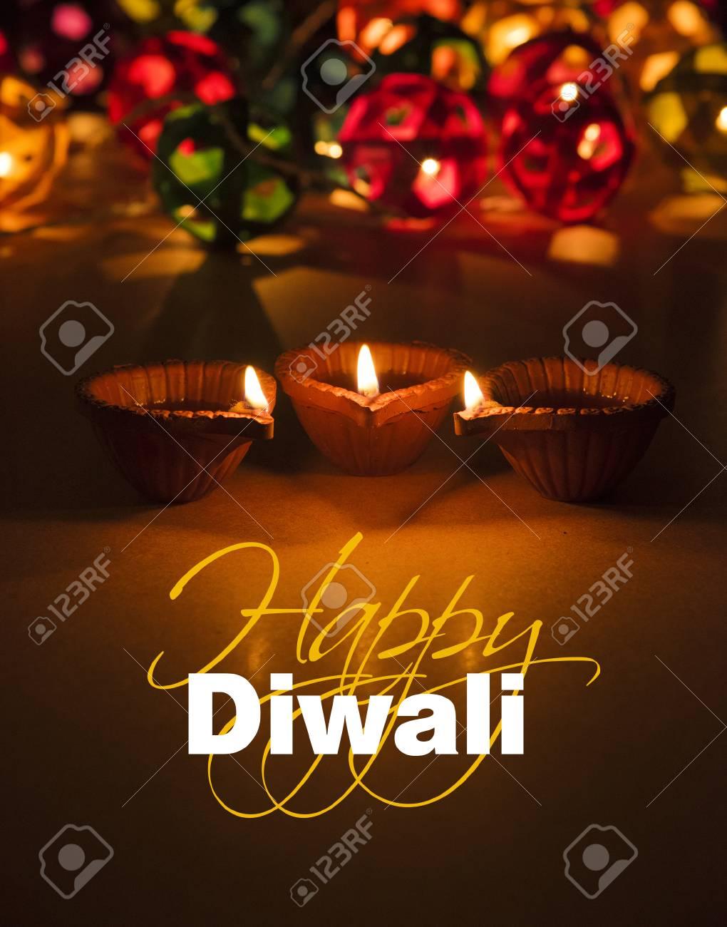 Stock Photo Of Diwali Greeting Card Showing Illuminated Diya Stock