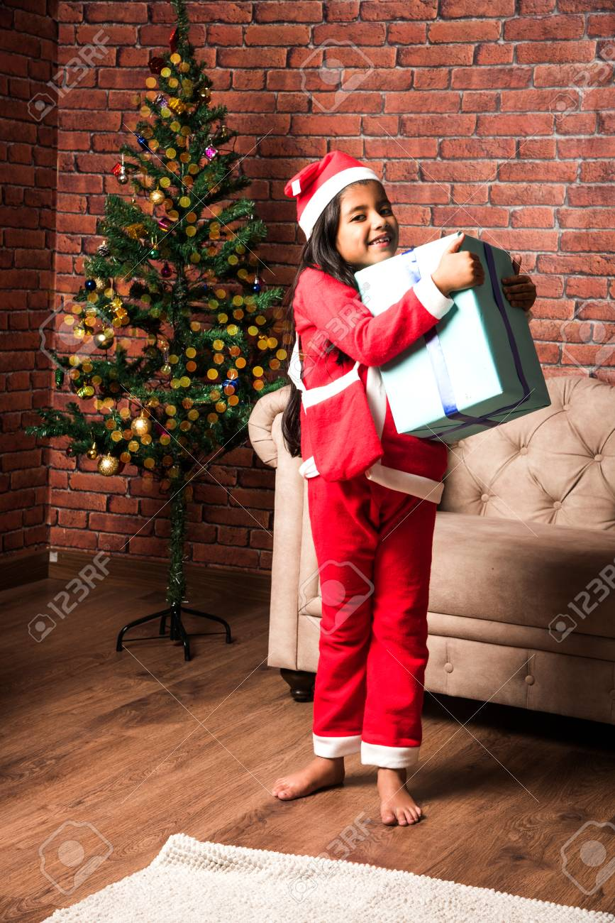 Indian Kids Celebrating Christmas With Christmas Gifts, Decorating ...