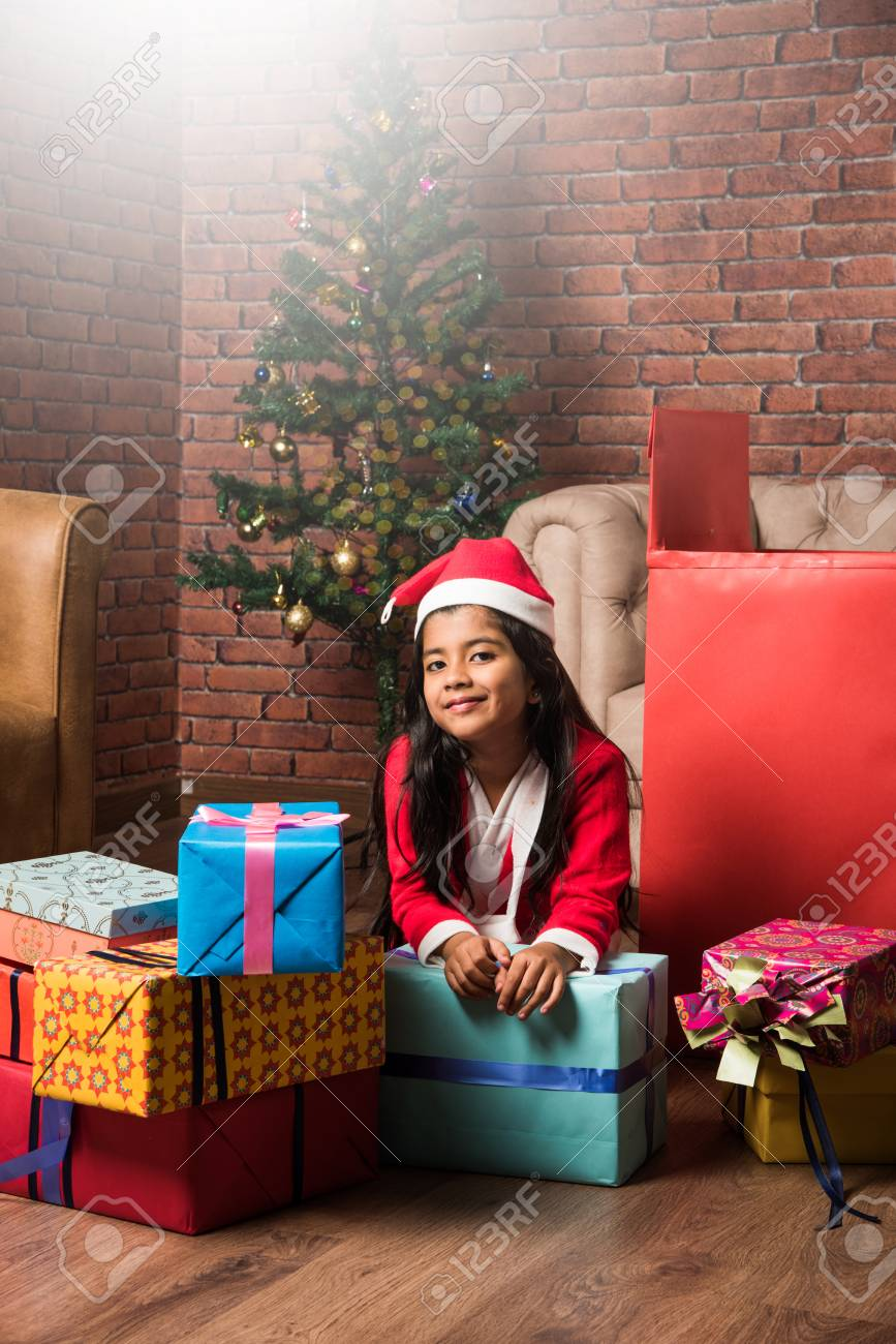 Indian kids celebrating christmas with christmas gifts, decorating