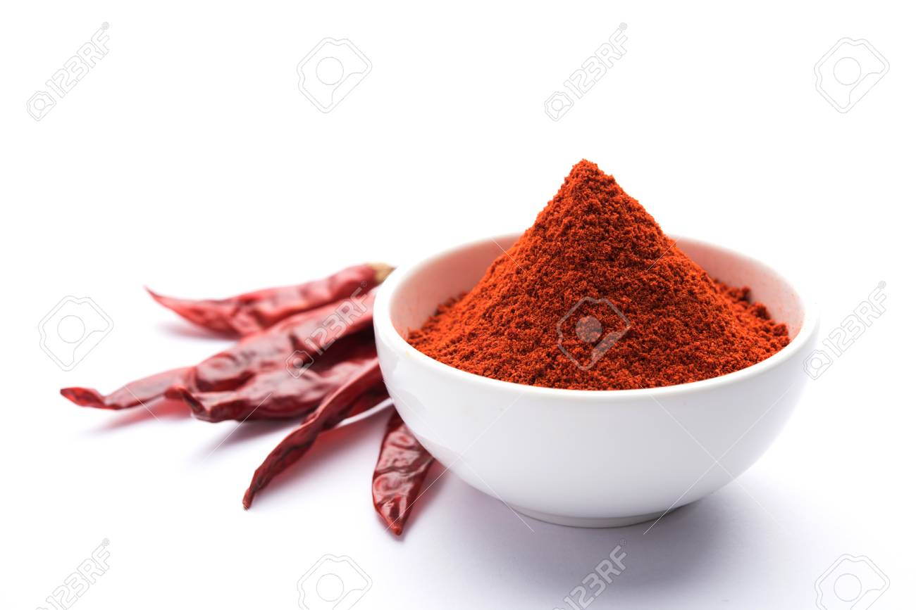 Red Chilly Powder in a bowl with dried red chillies over colourful background or pile of red chilli powder over plain background - 91679601