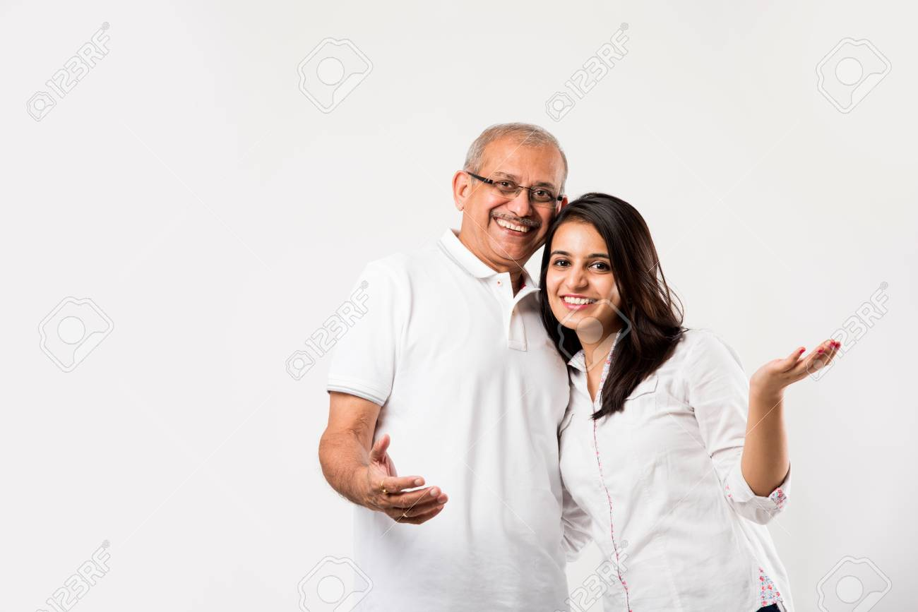 old Indian father with young girl standing isolated over white background - 117728724