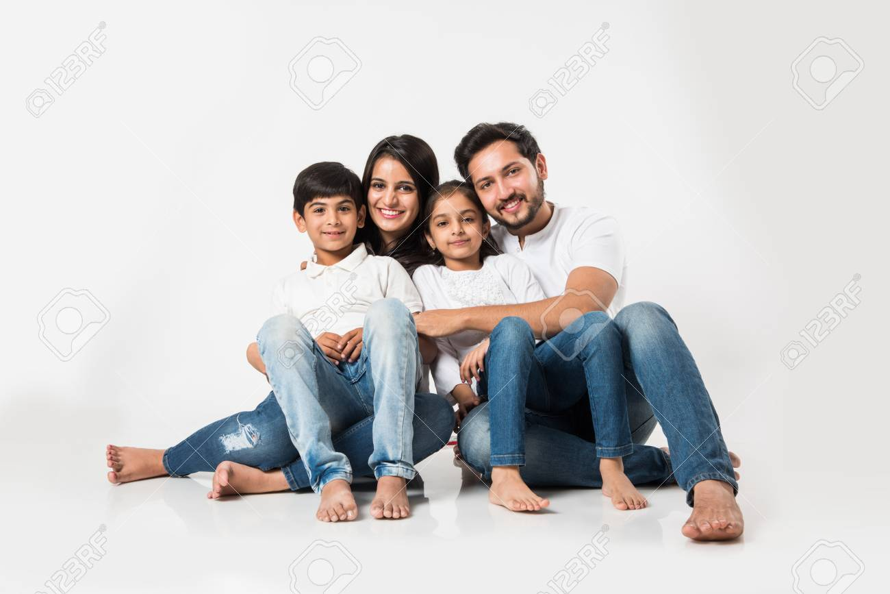 Young Indian/asian family sitting isolated over white background. selective focus - 117728715