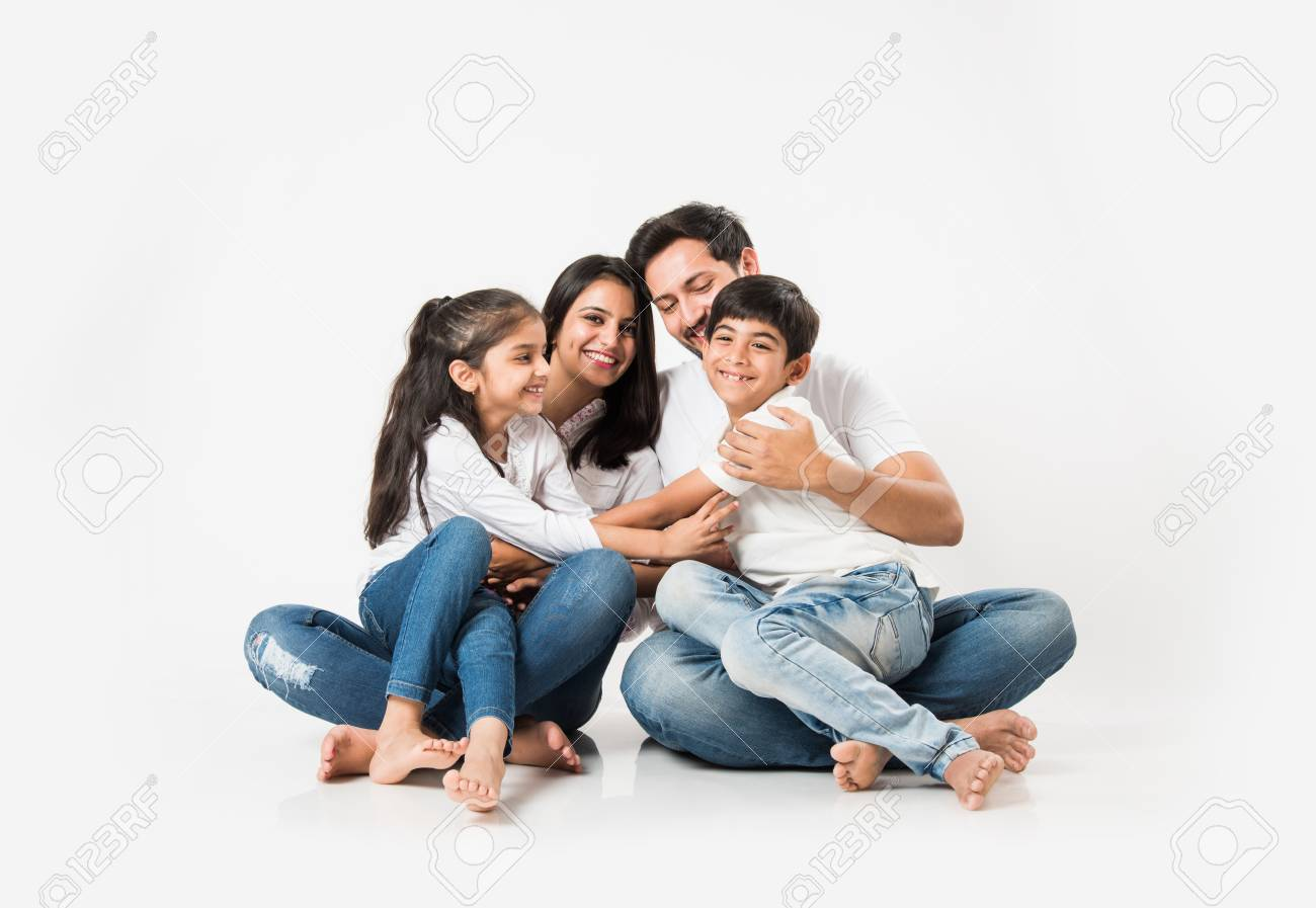 Young Indian/asian family sitting isolated over white background. selective focus - 117728716