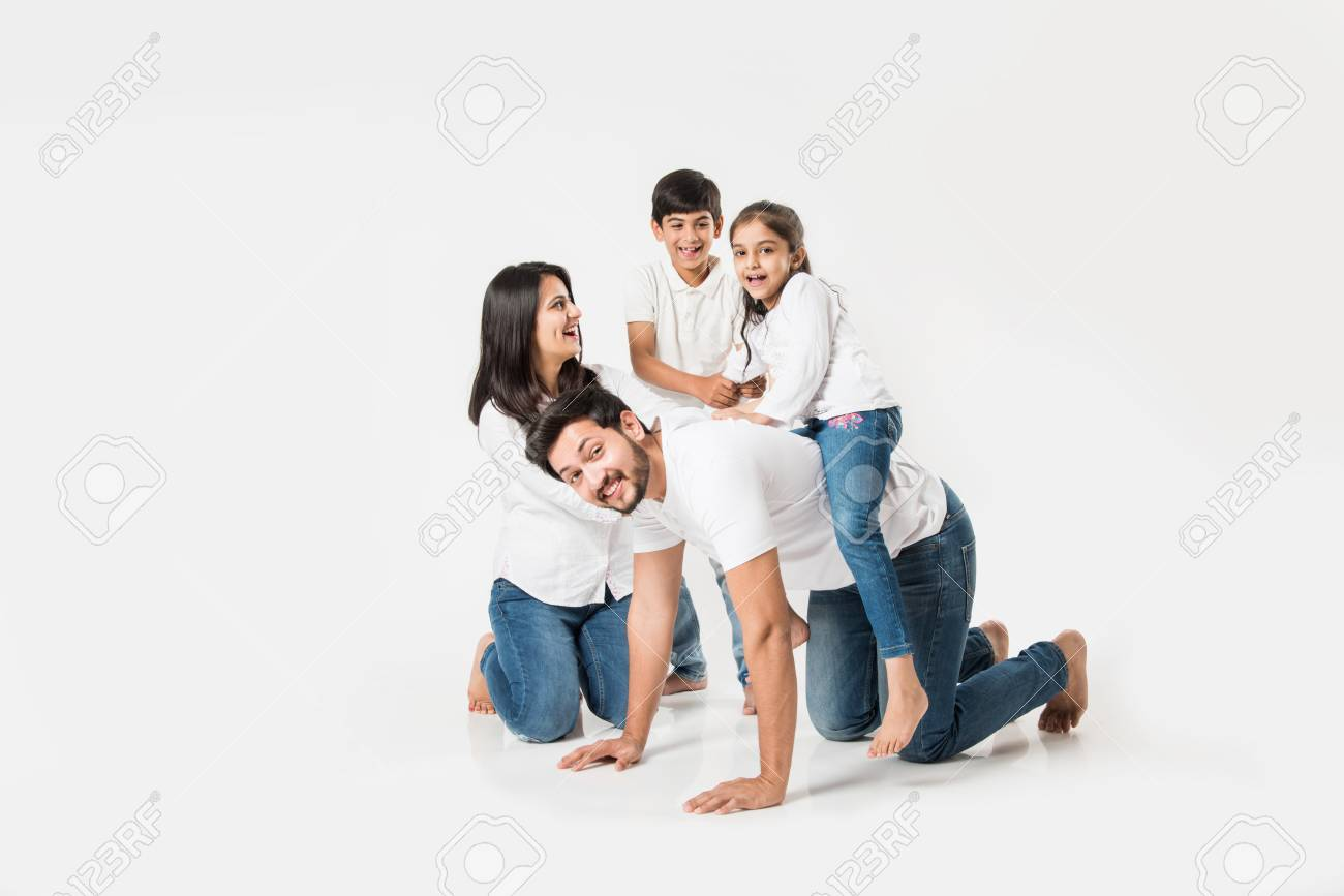 happy mad ride on father's back. Indian small girl sitting on Dad's back while mother and brother laughing. selective focus - 117728665