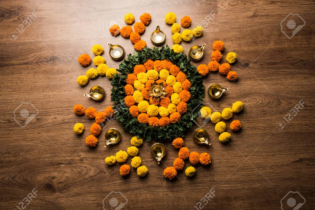 Flower Rangoli For Diwali Or Pongal Festival Made Using Marigold Stock Photo Picture And Royalty Free Image Image 156823092