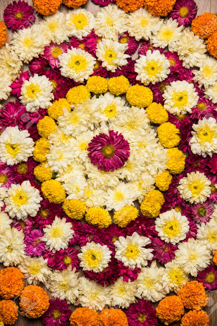 Flower Rangoli For Diwali Or Pongal Festival Made Using Marigold Stock Photo Picture And Royalty Free Image Image 156823172