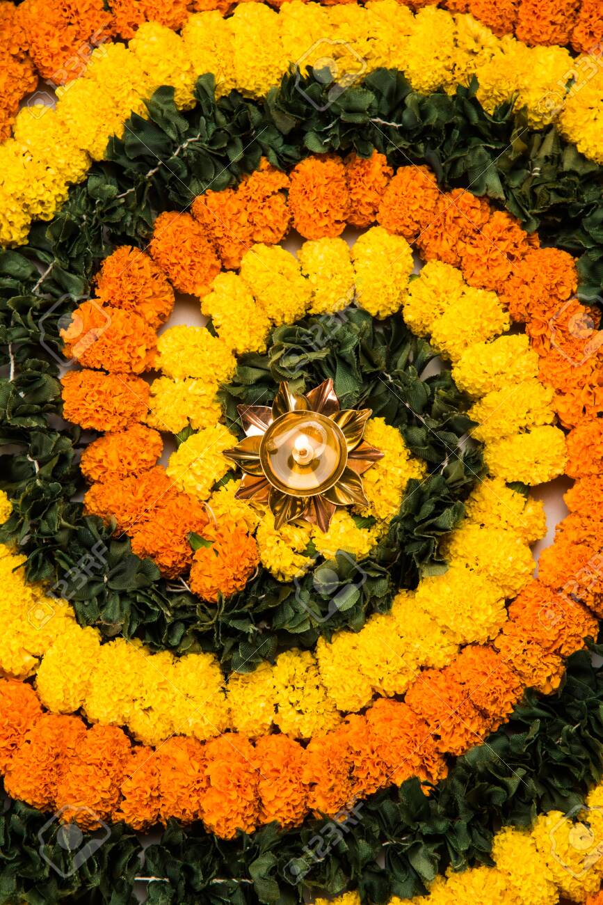Flower Rangoli For Diwali Or Pongal Festival Made Using Marigold Stock Photo Picture And Royalty Free Image Image 156899454
