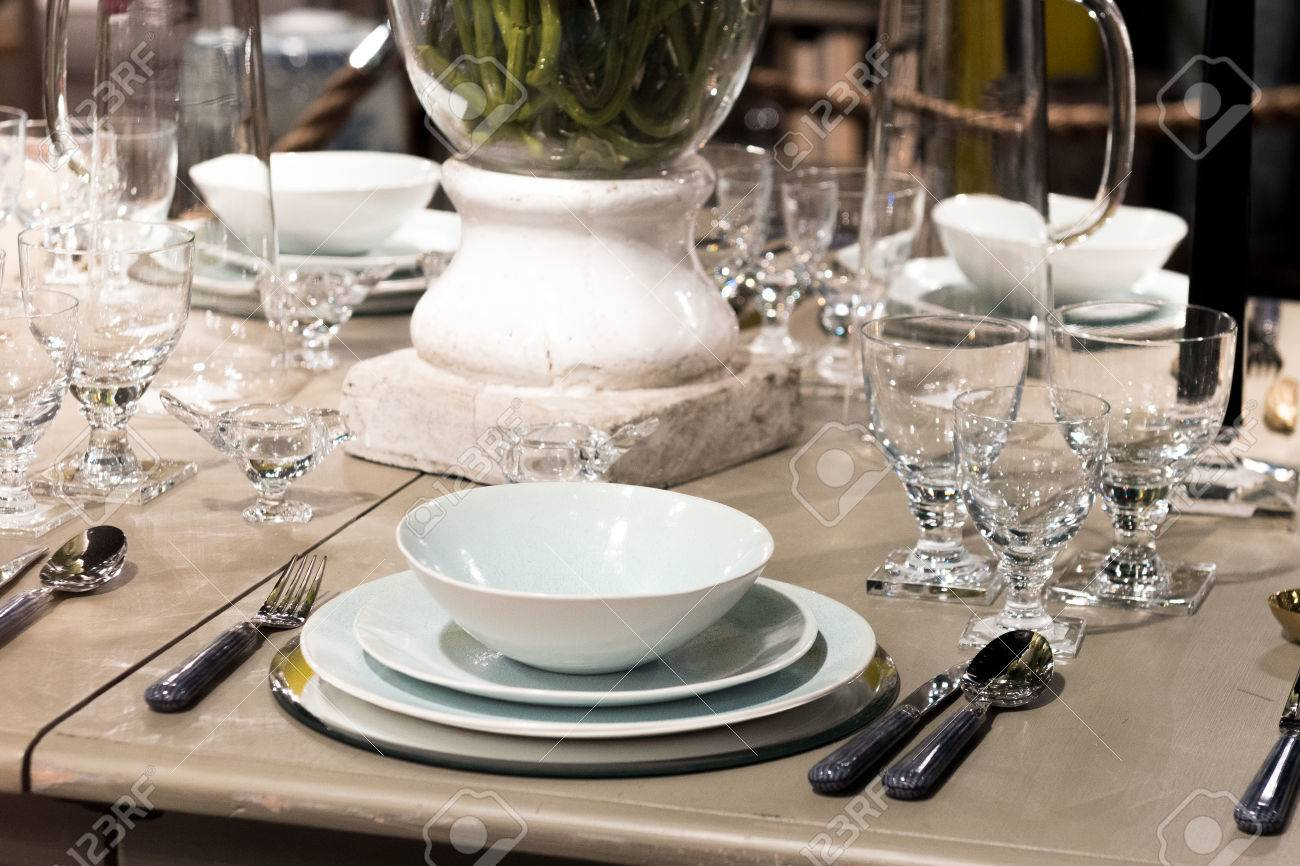 High-End Table Setting With Fine Cutlery, Glassware And Crockery ...