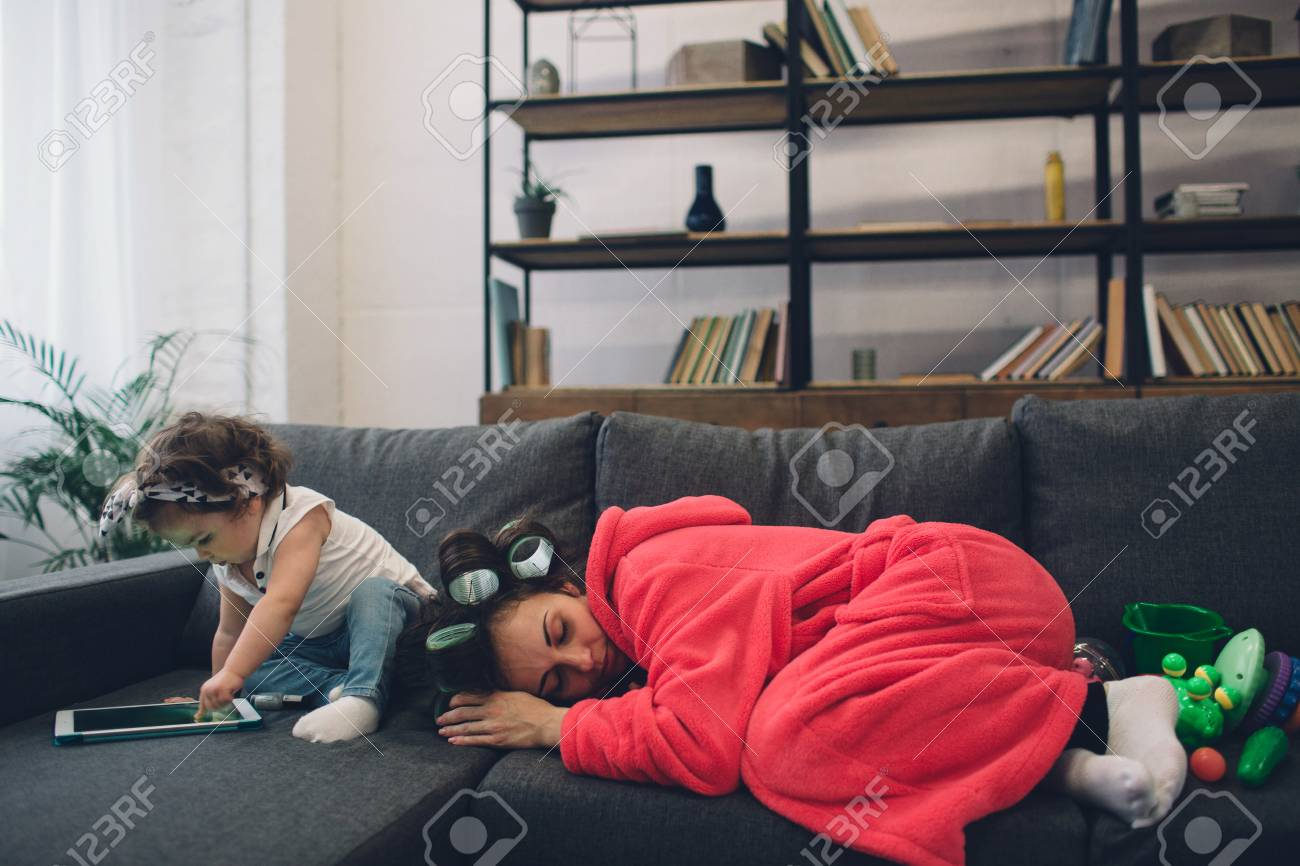 Young mother old is experiencing postnatal depression. Sad and tired woman with PPD. She does not want to play with her daughter - 93507702
