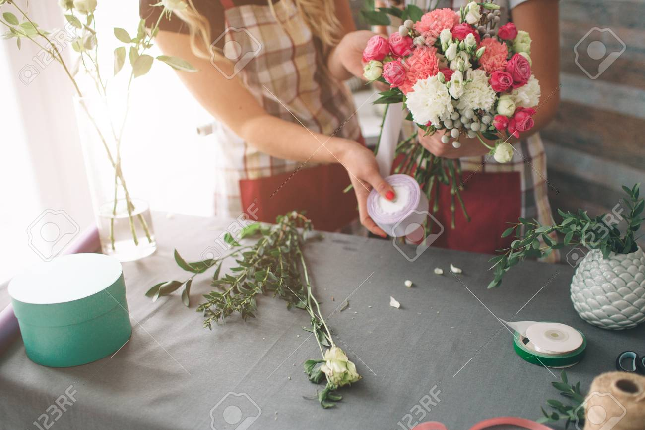 Flowers delivery top view florists creating order making rose flowers delivery top view florists creating order making rose bouquet in flower shop izmirmasajfo