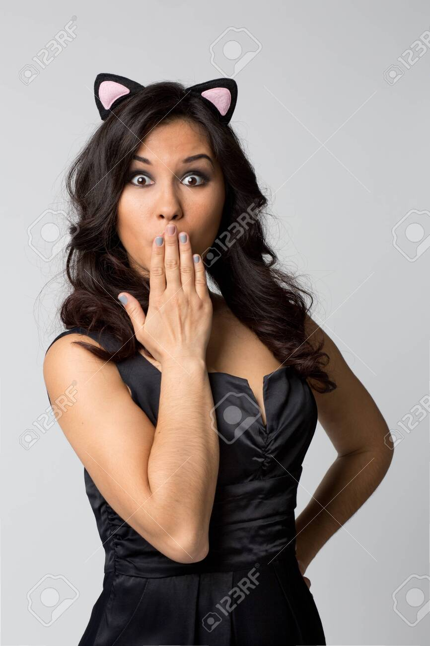 Beautiful make-up woman showing silence sign the fingers near lips on isolated light background - 143462404
